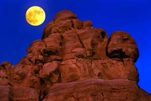 In this Sunday, Nov. 13, 2016, photo, the moon rises at Valley of Fire State Park in Moapa Valley, Nev., about one of the Seven Sisters rock formations. (L.E. Baskow/Las Vegas Sun via AP)